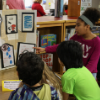 Students presenting human rights museum exhibits