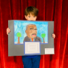 Student with artwork for Martin Luther King Art Invitational